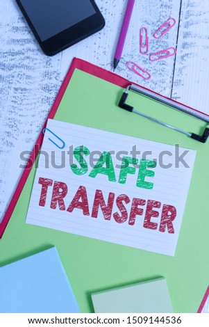 Word writing text Safe Transfer. Business concept for Wire Transfers electronically Not paper based Transaction Clipboard sheet pencil smartphone note clips notepads wooden background. #1509144536