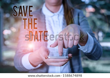 Word writing text Save The Date. Business concept for Systematized events Scheduled activity Recorded Filed Woman in grey suites holds mobile phone.