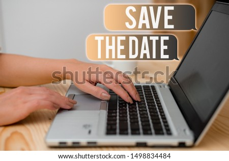 Word writing text Save The Date question. Business concept for asking someone to remember specific day or time woman laptop computer smartphone mug office supplies technological devices.