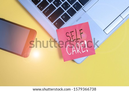 Word writing text Self Care. Business concept for practice of taking action preserve or improve ones own health Trendy laptop smartphone blank sticky note empty text colored background.
