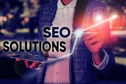 Word writing text Seo Solutions. Business concept for Search Engine Result Page Increase Visitors by Rankings.