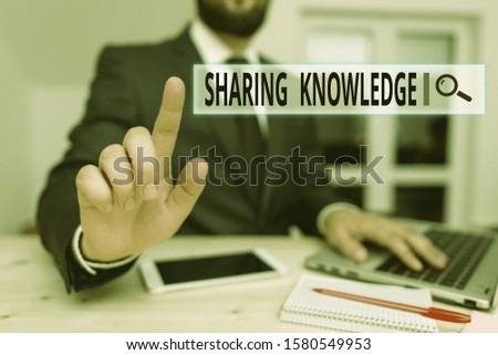 Word writing text Sharing Knowledge. Business concept for knowledge is exchanged among showing or organizations Male human wear formal clothes present presentation use hi tech smartphone.