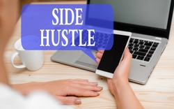 Word writing text Side Hustle. Business concept for way make some extra cash that allows you flexibility to pursue woman laptop computer smartphone mug office supplies technological devices.