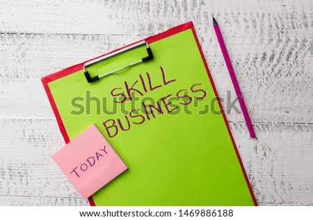 Word writing text Skill Business. Business concept for Ability to handle business venture Intellectual expertise Metal clipboard paper sheets marker sticky notes pad wooden background. #1469886188