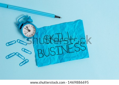 Word writing text Skill Business. Business concept for Ability to handle business venture Intellectual expertise Metal alarm clock blank crushed sheet marker clips sky colored background. #1469886695