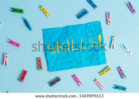 Word writing text Skills. Business concept for ability do something very well by nature Colored clothespin rectangle shaped reminder paper light blue background. #1469899613