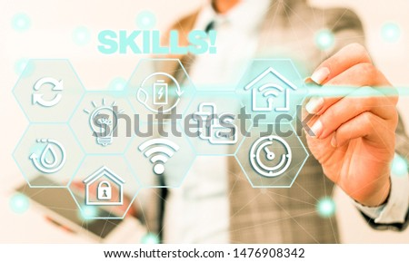 Word writing text Skills. Business concept for ability do something very well by nature Female human wear formal work suit presenting presentation use smart device. #1476908342