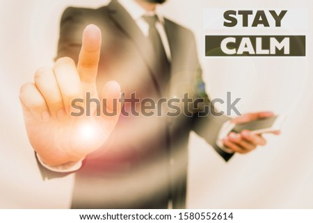 Word writing text Stay Calm. Business concept for Maintain in a state of motion smoothly even under pressure Male human wear formal work suit hold smart hi tech smartphone use one hand.