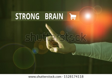 Word writing text Strong Brain. Business concept for own firm attitudes and opinions and are not easily influenced Finger pointing in the Dark with hand pointing in the copy space.