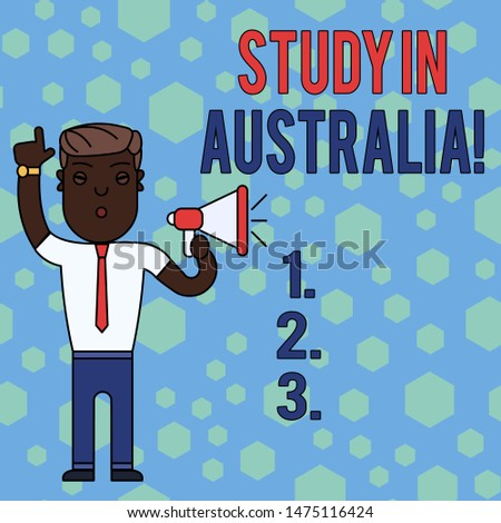 Word writing text Study In Australia. Business concept for going into foreign country order complete your studies Man Standing with Raised Right Index Finger and Speaking into Megaphone.