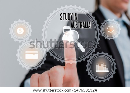 Word writing text Study In Australia. Business concept for going into foreign country order complete your studies Woman wear formal work suit presenting presentation using smart device.