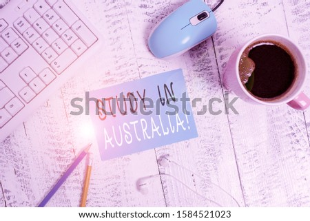 Word writing text Study In Australia. Business concept for going into foreign country order complete your studies technological devices colored reminder paper office supplies keyboard mouse.