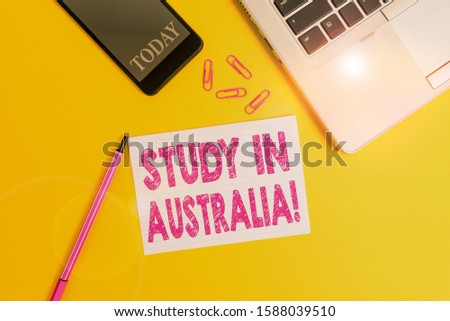 Word writing text Study In Australia. Business concept for going into foreign country order complete your studies Trendy open laptop smartphone marker paper sheet clips colored background.