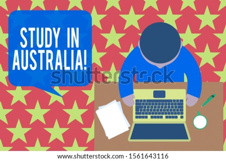 Word writing text Study In Australia.Business concept for going into foreign country order complete your studies Upper view young man sitting working table laptop documents coffee cup pen.
