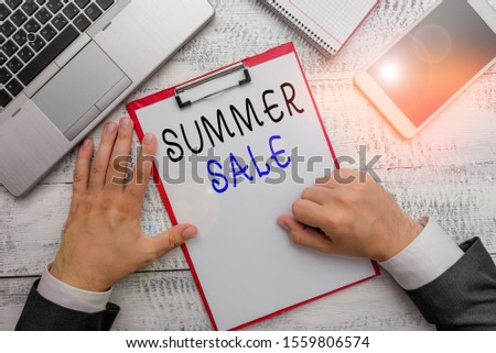 Word writing text Summer Sale. Business concept for time when a store sells products at much lower prices than usual Hand hold writing equipment tool near modern high technology laptop device.