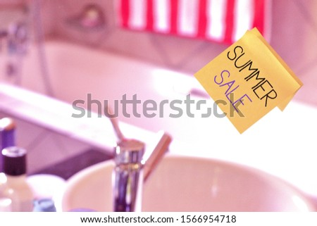 Word writing text Summer Sale. Business concept for time when a store sells products at much lower prices than usual Piece of square yellow sheet use to give notation stick to washroom mirror.