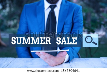 Word writing text Summer Sale. Business concept for time when a store sells products at much lower prices than usual Businessman with mobile phone in his hand.
