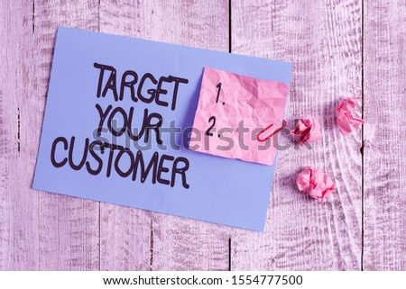 Word writing text Target Your Customer. Business concept for Tailor Marketing Pitch Defining Potential Consumers Wrinkle paper and cardboard plus stationary placed above wooden background.