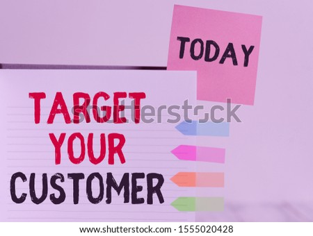 Word writing text Target Your Customer. Business concept for Tailor Marketing Pitch Defining Potential Consumers Hard cover note book sticky note arrow banners inserted clear background.