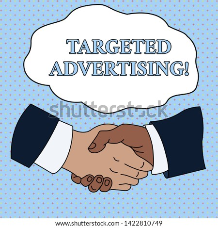 Word writing text Targeted Advertising. Business concept for Online Advertisement Ads based on consumer activity Hand Shake Multiracial Male Business Partners Colleagues Formal Shirt Suit.