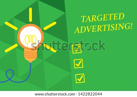 Word writing text Targeted Advertising. Business concept for Online Advertisement Ads based on consumer activity Big idea light bulb. Successful turning idea invention innovation. Startup.