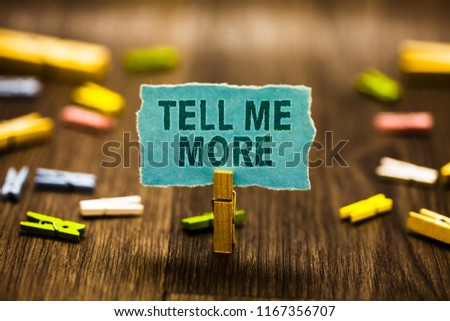 Word writing text Tell Me More. Business concept for A call to start a conversation Sharing more knowledge Clothespin holding blue paper note reminder clothespins wooden floor. Stock photo ©