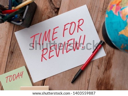 Word writing text Time For Review. Business concept for formal assessment of something with intention instituting change Writing equipments and sheets with artificial globe on the wooden desk. #1403559887