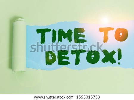 Word writing text Time To Detox. Business concept for when you purify your body of toxins or stop consuming drug Cardboard which is torn in the middle placed above a plain table backdrop. #1555015733