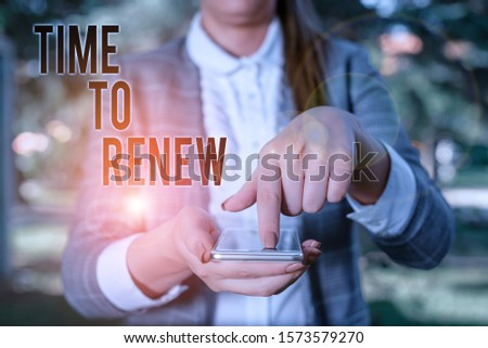 Word writing text Time To Renew. Business concept for Continue the insurance acquired Life and property protection Woman in grey suites holds mobile phone. #1573579270