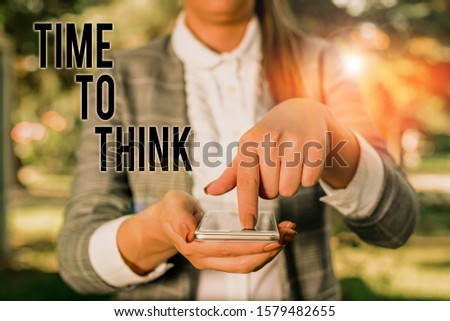 Word writing text Time To Think. Business concept for Reconsider some things Reflection time Moment to ponder Woman in grey suites holds mobile phone. #1579482655