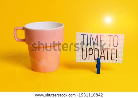 Word writing text Time To Update. Business concept for act updating something someone or updated version program Cup empty paper blue clothespin rectangle shaped reminder yellow office. #1531110842