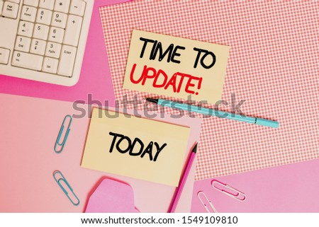 Word writing text Time To Update. Business concept for act updating something someone or updated version program Writing equipments and computer stuffs placed above colored plain table. #1549109810