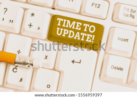 Word writing text Time To Update. Business concept for act updating something someone or updated version program White pc keyboard with empty note paper above white background key copy space. #1556959397