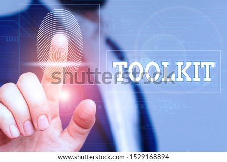 Word writing text Toolkit. Business concept for set of tools kept in a bag or box and used for a particular purpose Male human wear formal work suit presenting presentation using smart device. #1529168894