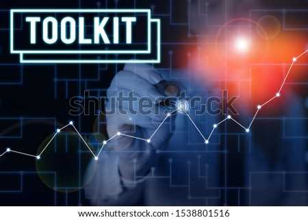 Word writing text Toolkit. Business concept for set of tools kept in a bag or box and used for a particular purpose Woman wear formal work suit present presentation using smart latest device. #1538801516