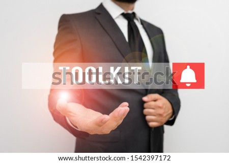 Word writing text Toolkit. Business concept for set of tools kept in a bag or box and used for a particular purpose Male human with beard wear formal working suit clothes raising one hand up. #1542397172