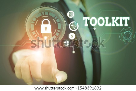 Word writing text Toolkit. Business concept for set of tools kept in a bag or box and used for a particular purpose Woman wear formal work suit present presentation using smart latest device. #1548391892