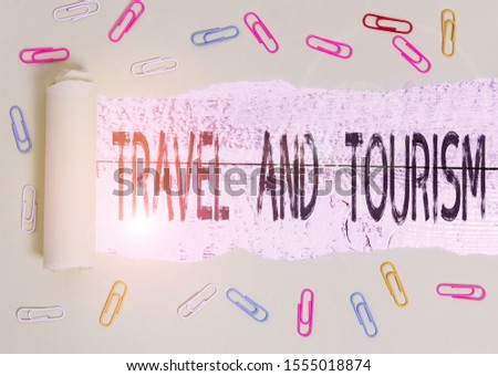 Word writing text Travel And Tourism. Business concept for Temporary Movement of People to Destinations or Locations Paper clip and torn cardboard placed above a wooden classic table backdrop.