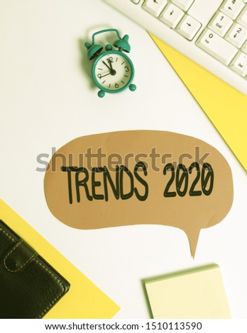 Word writing text Trends 2020. Business concept for Upcoming year prevailing tendency Widely Discussed Online Flat lay with copy space on bubble paper clock and paper clips.