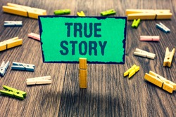 Word writing text True Story. Business concept for The day to day experiences of an individual in his entire life Clothespin holding green paper note several clothespins wooden floor.
