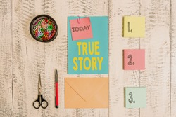 Word writing text True Story. Business concept for The day to day experiences of an individual in his entire life Envelope letter sticky note ballpoint clips can scissors wooden background.