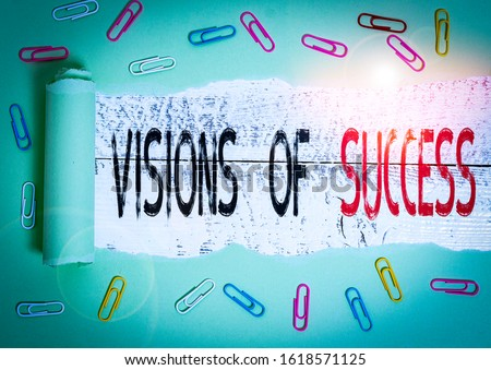 Word writing text Visions Of Success. Business concept for Clear End Result of Purpose Goal Perspective Plan Paper clip and torn cardboard placed above a wooden classic table backdrop.