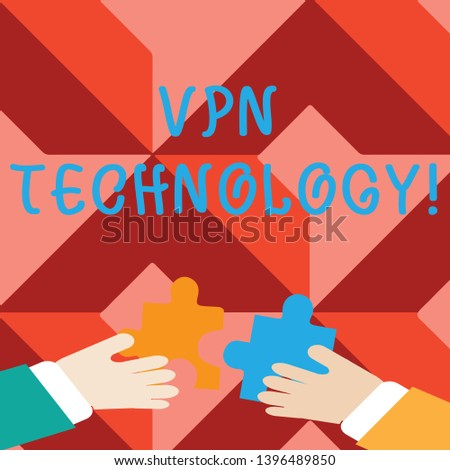 Word writing text Vpn Technology. Business concept for programming that creates a safe and encrypted connection Two Hands Holding Colorful Jigsaw Puzzle Pieces about to Interlock the Tiles.