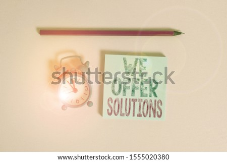 Word writing text We Offer Solutions. Business concept for Offering help assistance Experts advice strategies ideas Metal vintage alarm clock wakeup blank notepad marker colored background. #1555020380