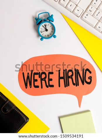 Word writing text We Re Hiring. Business concept for Advertising Employment Workforce Placement New Job Flat lay with copy space on bubble paper clock and paper clips.