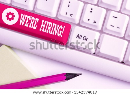 Word writing text We Re Hiring. Business concept for recently employ someone or pay him to do particular job White pc keyboard with empty note paper above white background key copy space.