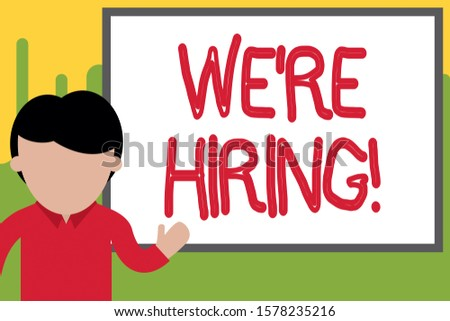 Word writing text We Re Hiring. Business concept for recently employ someone or pay him to do particular job Young man standing in front whiteboard pointing to project. photo Art.