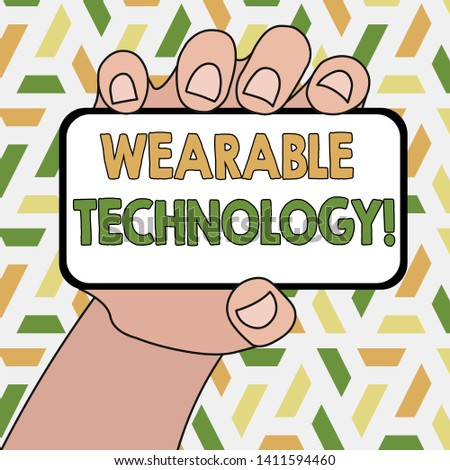 Word writing text Wearable Technology. Business concept for electronic devices that can be worn as accessories Closeup of Smartphone Device Held in Hand with Blank Screen and Text Space.