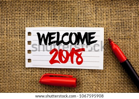 Word writing text Welcome 2018. Business concept for Celebration New Celebrate Future Wishes Gratifying Wish written on Notebook Paper on the jute background with marker next to it. #1067595908