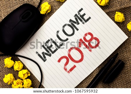 Word writing text Welcome 2018. Business concept for Celebration New Celebrate Future Wishes Gratifying Wish written on Notebook Paper on the jute background Marker and Mouse next to it. #1067595932